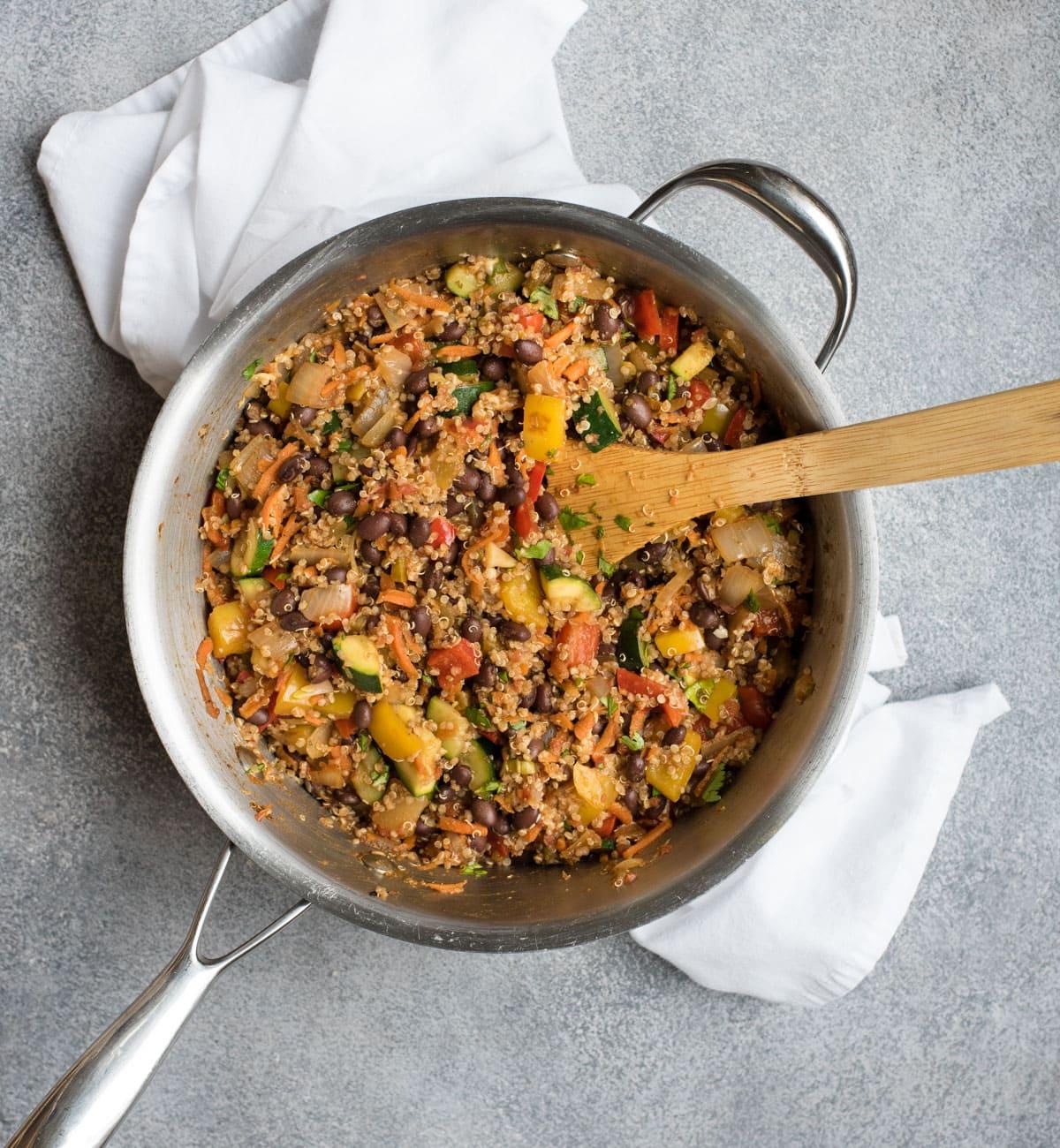 Black bean quinoa casserole process picture of quinoa and vegetables in a saute pan