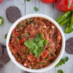 10 minute fresh blender salsa with tomatoes, onion, jalapeño, cilantro and just the right amount of kick to have you coming back for more.