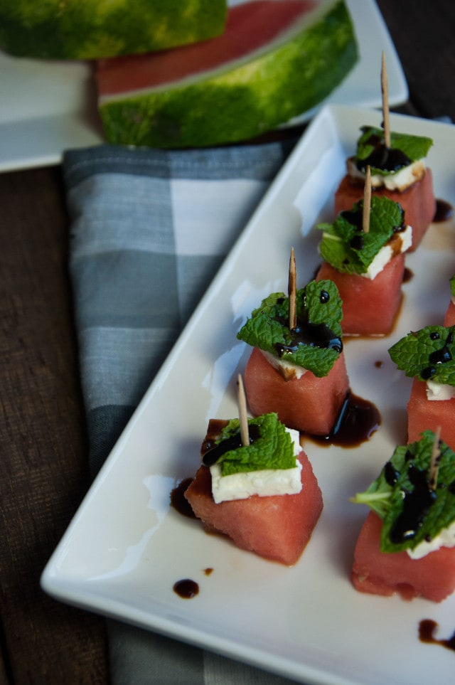 These watermelon feta mint skewers are refreshing as is, but the tangy balsamic glaze makes this healthy appetizer absolutely delicious!