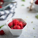 Photo of bowl with Raspberries with lemon zest and mint