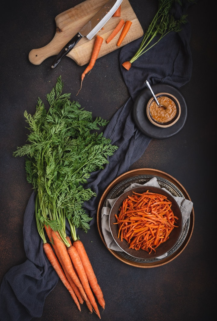 overhead picture of curry carrot fries with bowl of peanut sauce