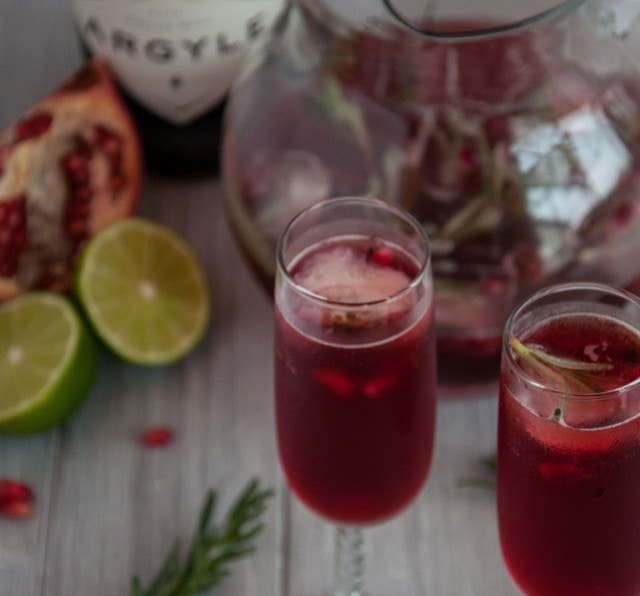 Rosemary pomegranate mimosas encapture the essence of relaxed holiday gatherings where festive simplicity leaves more time to enjoy with family and friends.