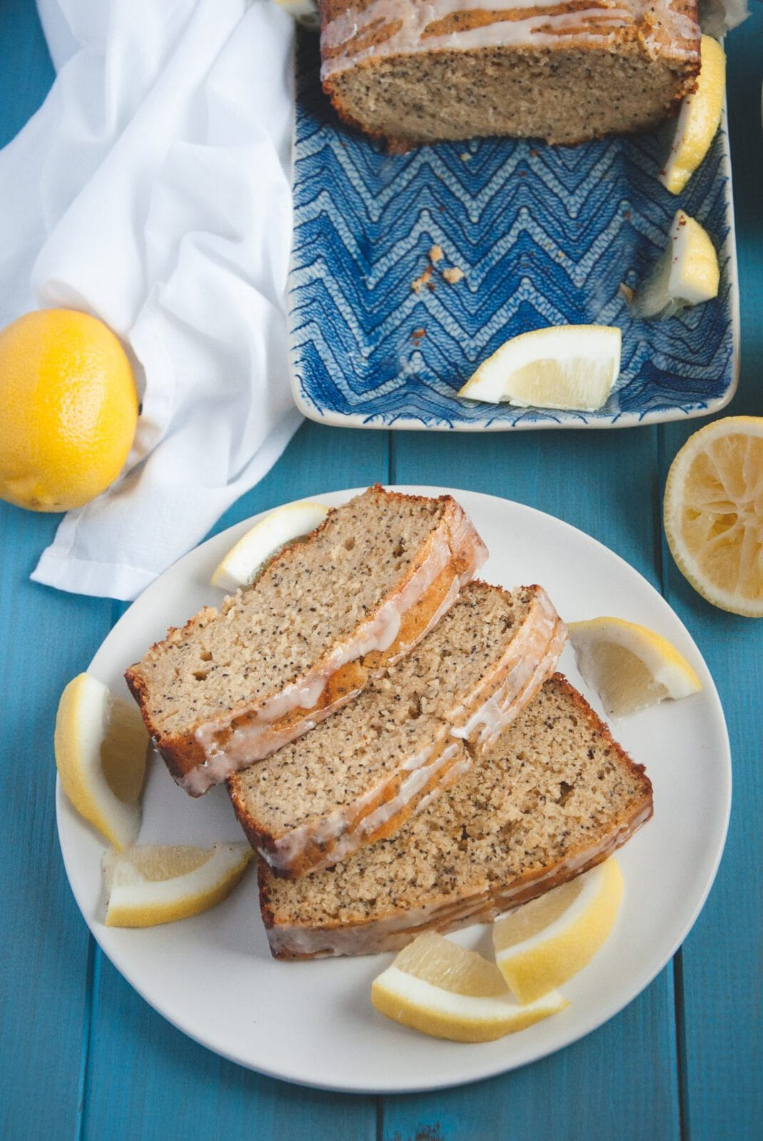 Plate with Whole Wheat Lemon Poppy Seed Bread with glaze