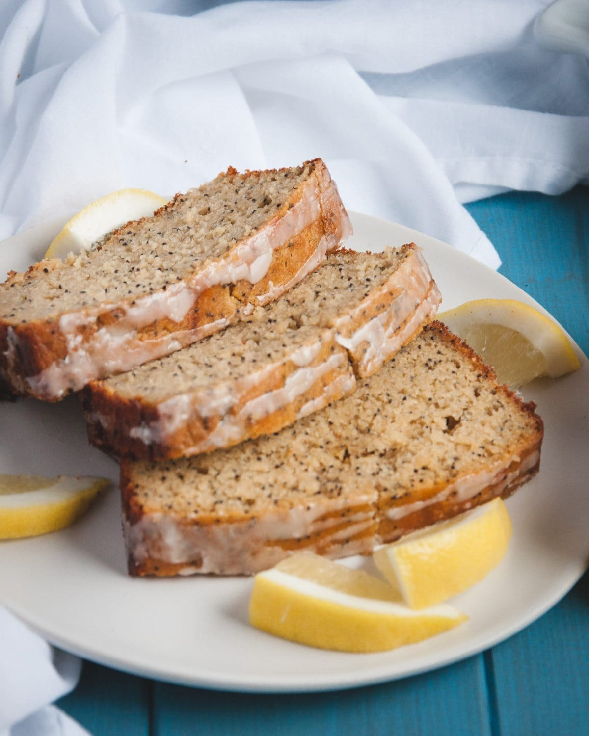 slices of Whole Wheat Lemon Poppy Seed Bread on a white plate