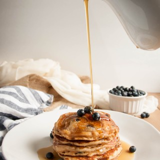 These thick, rich, delicious pancakes are a breakfast winner both in taste and nutrition, made with whole wheat flour, Greek yogurt, and blueberries.