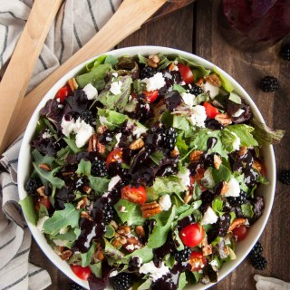 This deliciously fresh summer salad with feta, pecans, basil and blackberry vinaigrette is a perfect light and healthy salad for a quick weeknight meal.