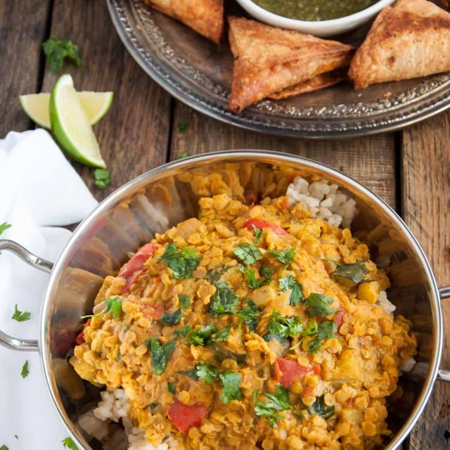 Filled with aromatic spices, lentils never tasted so good! This healthy red lentil dal is inexpensive, nutritious, high in protein, and brimming with flavor.