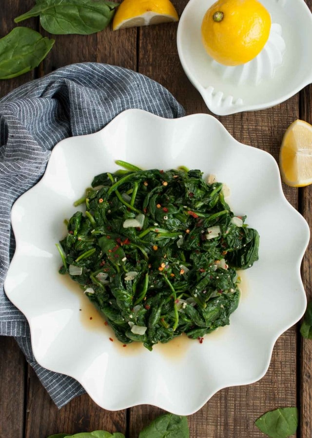 quick and easy sauteed spinach overhead picture with red pepper flakes