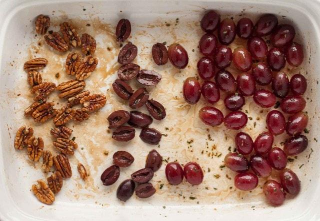 pan with pecans, kalamata olives and grapes