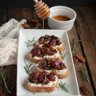 Crostini with Roasted Grapes, Goat Cheese, and Pecans