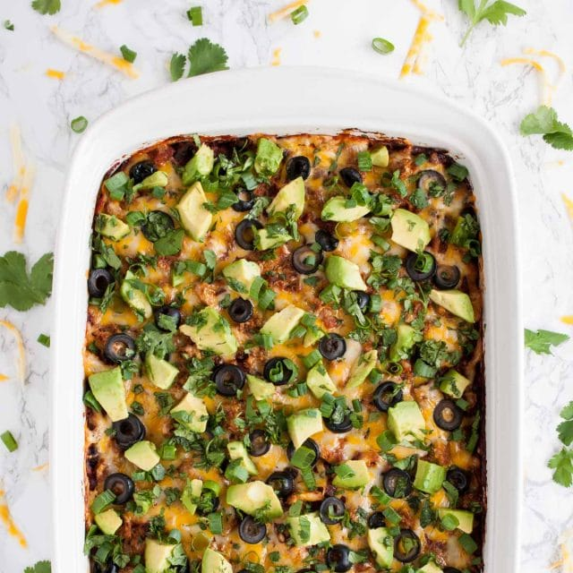 This easy chicken enchilada casserole is full of flavor and an ultimate crowd pleaser. It has the same great enchilada taste but with way less work!
