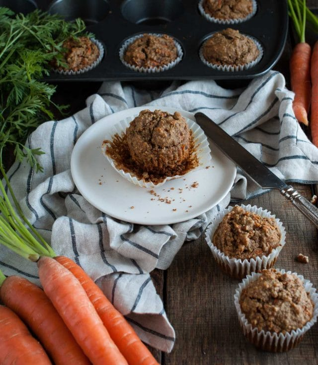 These healthy carrot muffins are made with oat flour, applesauce, honey, coconut oil and a tasty mix of spices that will remind you of carrot cake!
