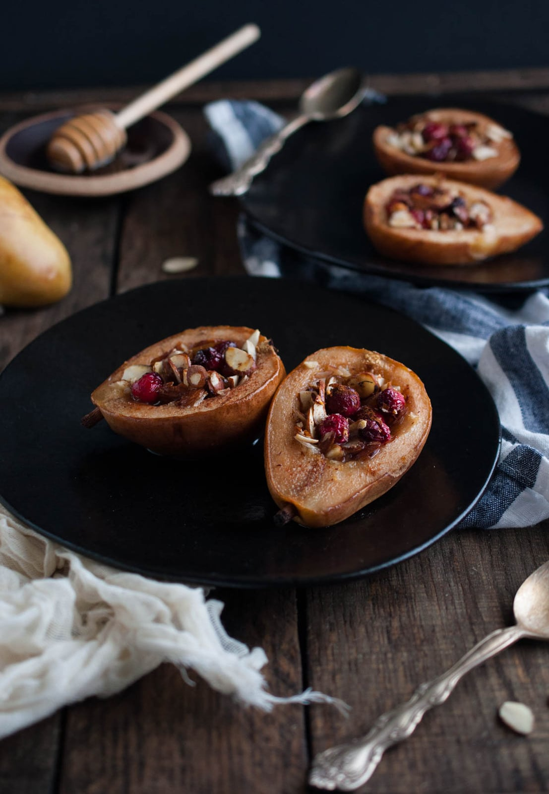 These baked pears with honey and almonds are the perfect healthy dessert for the holidays with cranberries and a nutty crunch all for 200 calories!