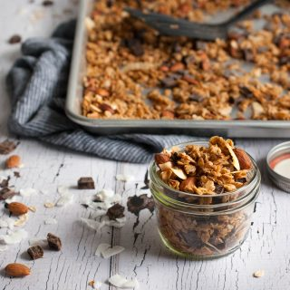 Crunchy chocolate coconut granola with toasty almonds, coconut oil, honey, and a dash of cinnamon to make your breakfast the best meal of the day.