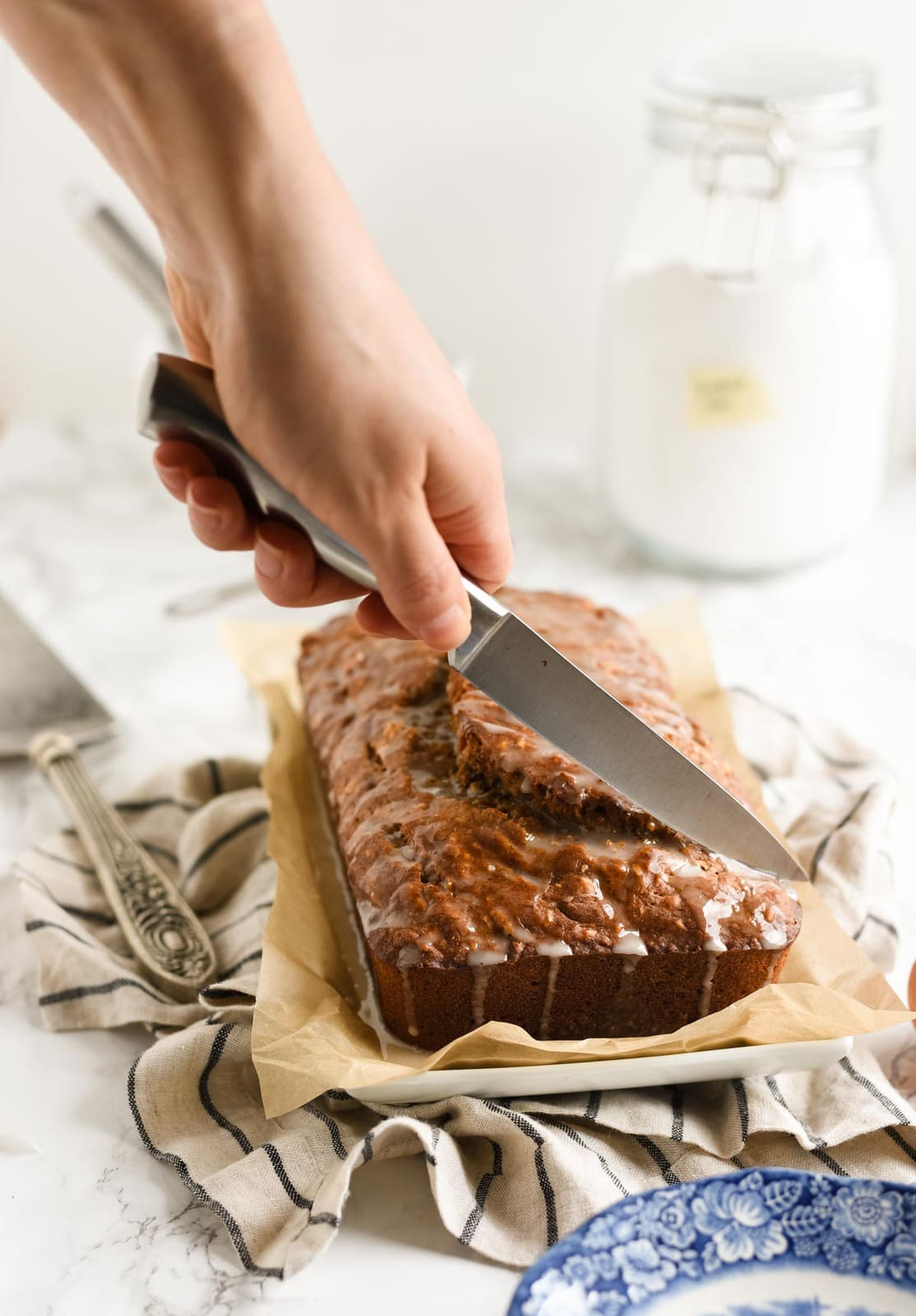 Glazed banana bread being sliced