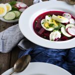 cold borscht with sour cream, boiled egg, and dill