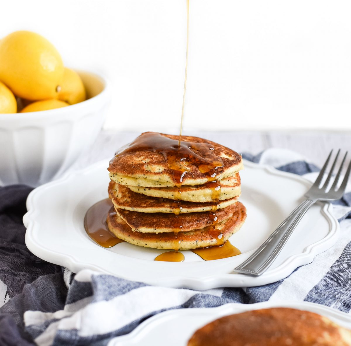 syrup drizzled over Lemon poppy seed pancakes photo