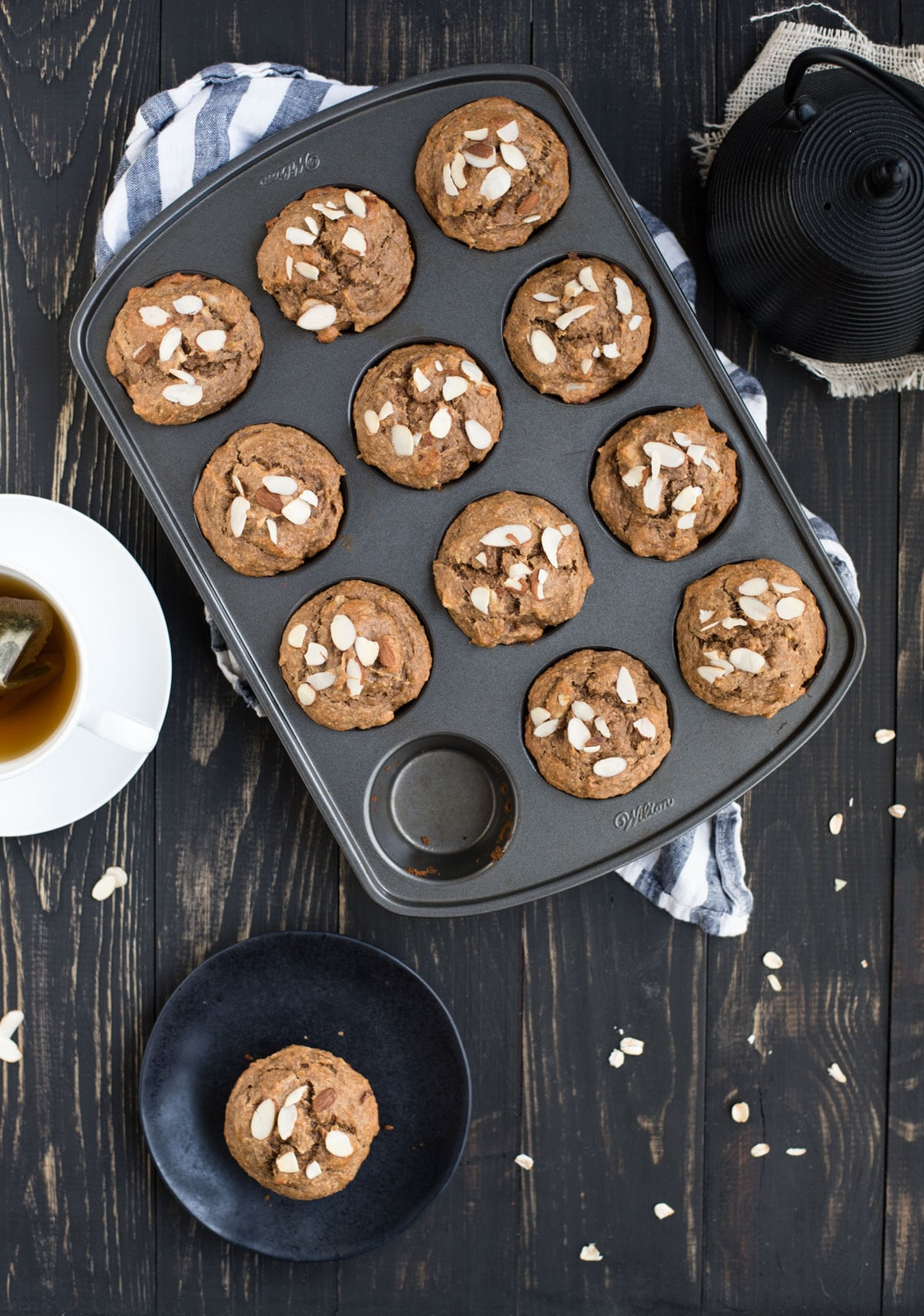 banana almond muffins with tea kettle from overhead