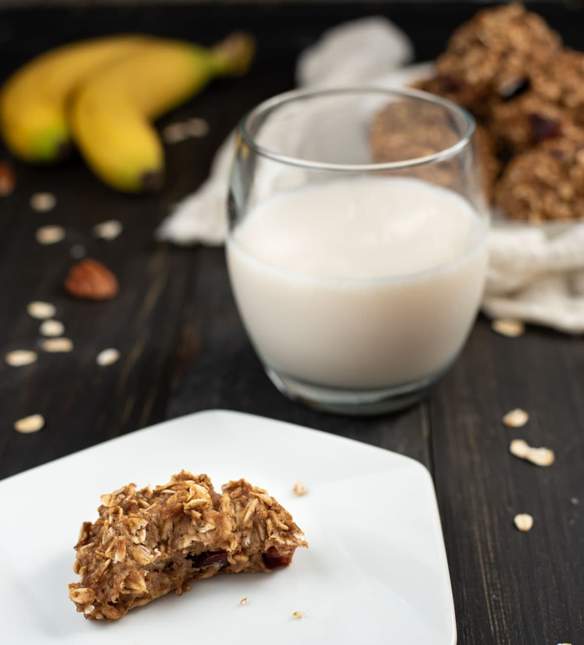 Healthy banana oat cookie on a plate with a glass of milk