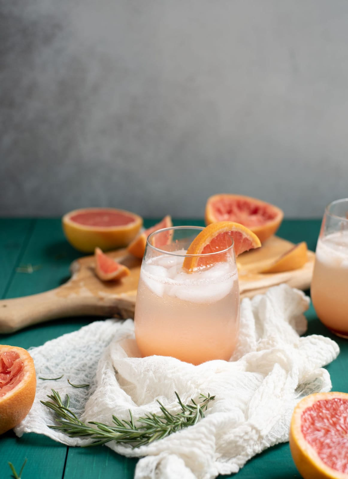 Rosemary grapefruit mocktail in glass with ice cubes