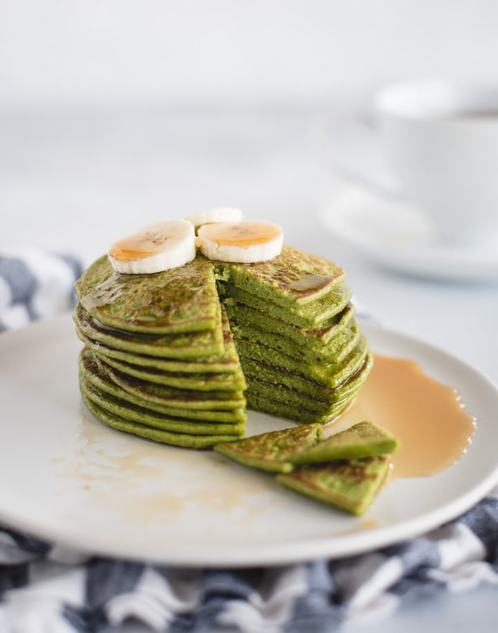 plate with stack of green pancakes