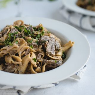 close up picture of white bowl full of beef stroganoff