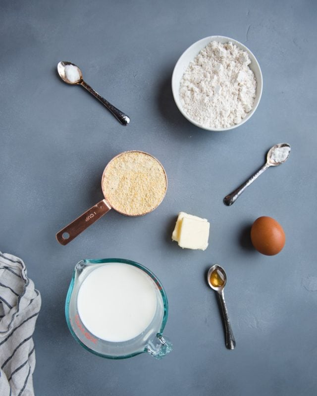 overhead picture of whole wheat cornbread ingredients on a gray background
