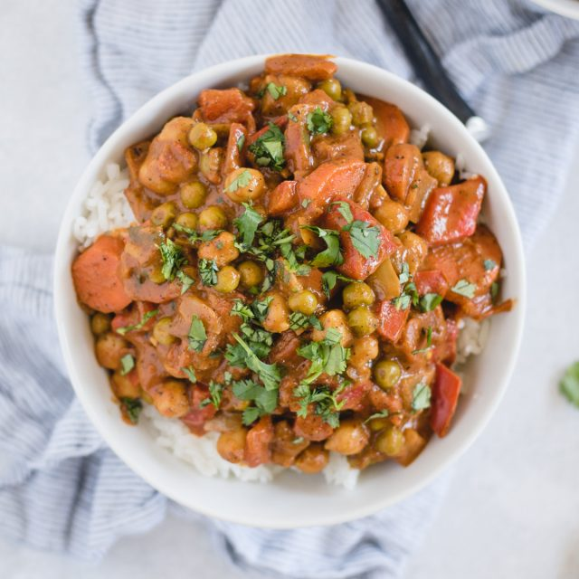 bowl of vegan chickpea curry on white background