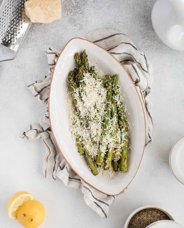 overhead picture of air fryer asparagus against a light background