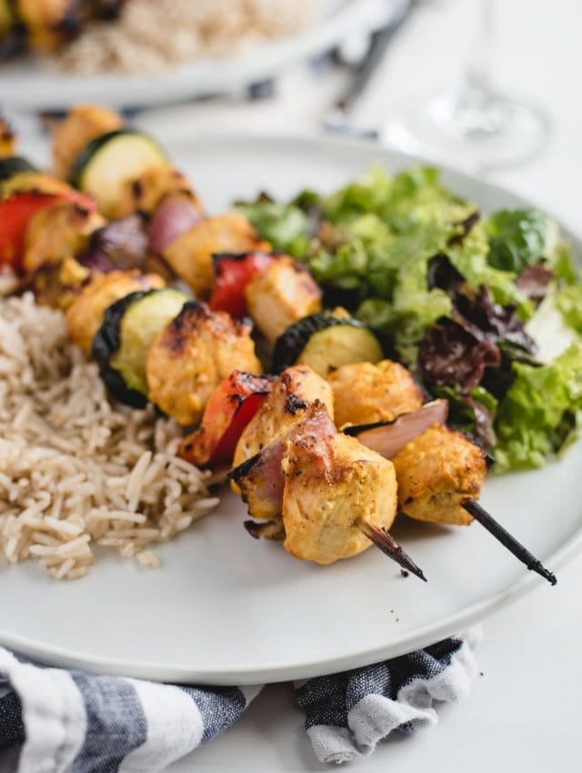 close up picture of marinated yogurt chicken kabobs on a plate
